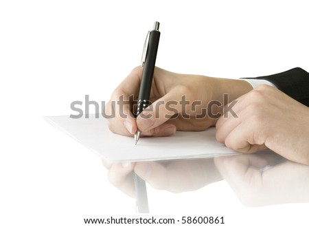 pen in hand writing on the white page with reflection