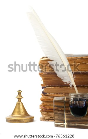 Pen in the inkstand and old books