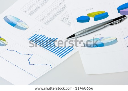 pen laying on report with diagrams