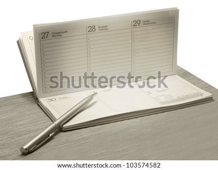 Pen lying on opened diary