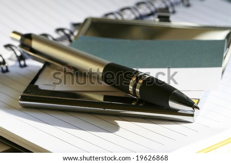 pen lying on opened  notebook