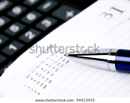 Pen,  notebook page and calculator. macro