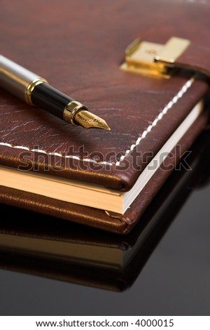 Pen on a closed diary