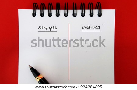 Pen on note book with text written STRENGTH and WEAKNESS - concept of making personal defined lists of strong and weak points for a job interview or self improvement Сток-фото ©