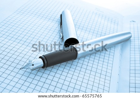 pen on notebook in blue colors