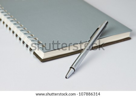 Pen on notebook in  business look