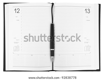 Pen on notebook organizer close-up isolated on white background