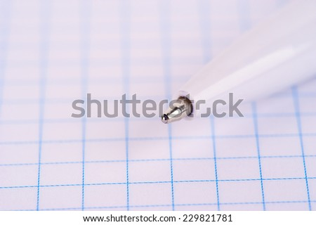 pen on notebook page, school or business background