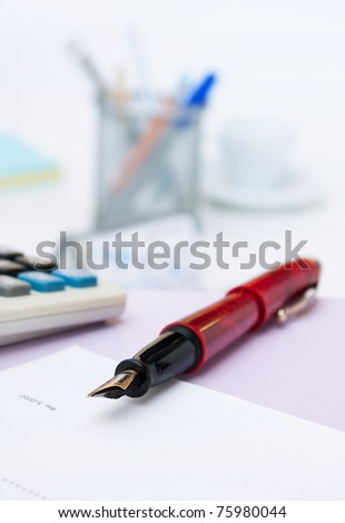 pen on the desk in the office