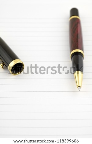 pen on the sheet of paper - stock photo