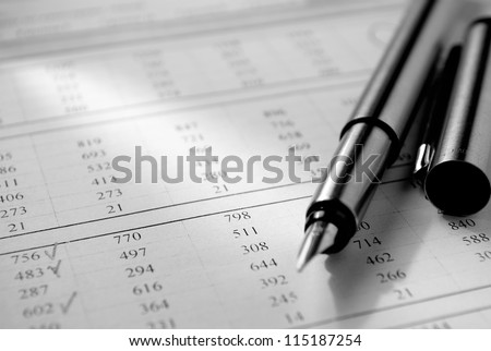 pen, paper with numbers and a beam of light