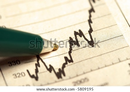 Pen pointing on the increasing graph