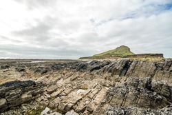 Pen Pyrod Mountain taken from the causeway across the sea to The