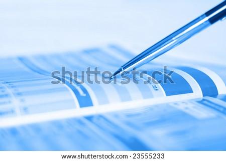 Pen showing diagram in financial magazine