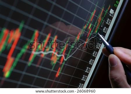 pen showing financial chart on screen