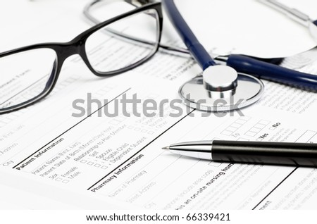Pen stethoscope and glasses over blank Prescription form with patient and pharmacy information