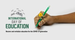 pen tightly knotted with hand. creative idea for hard study, Perseverance, diligence, persistence, International Education Day, 24 January, Recover and revitalize education for the COVID 19 generation