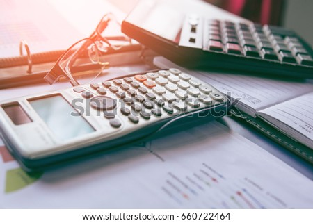 Pen with business graphs and charts report , calculator on desk of financial planing. Financial abstract concepts. #660722464