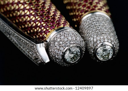Pen with diamonds and ruby isolated on black background