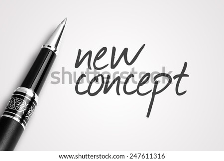 pen writes new concept on paper