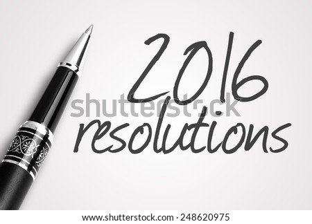 pen writes 2016 resolutions on paper