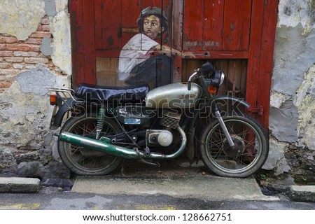 PENANG, MALAYSIA-FEB 14: General view of a mural 'Boy on a Bike'� painted by Ernest Zacharevic in Penang on Feb.14, 2012. The mural is one of the 9 murals paintings in early 2012.