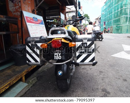 PENANG, MALAYSIA - MAY 8: Police Motorcycle park on the street at little india area on May 8, 2011. Georgetown, Penang, Malaysia.  The motorbike have 2 license plates in Malaysian and Thai