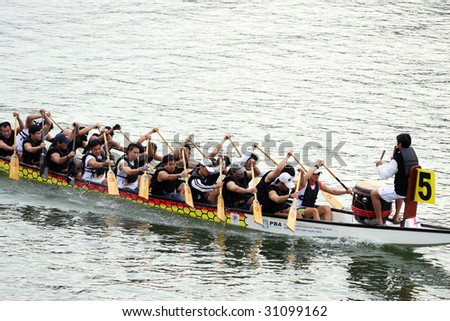 PENANG - MAY 23: A dragon boat is racing at Penang International Dragonboat Festival May 23-24, 2009 in Penang, Malaysia.