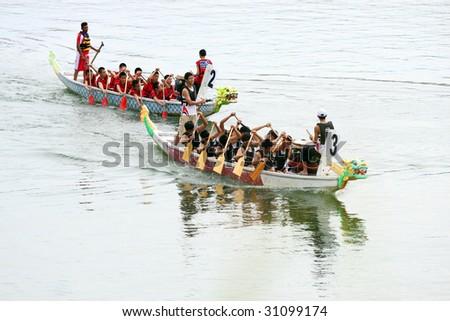 PENANG - MAY 23: Two dragon boat take off for racing at Penang International Dragonboat Festival May 23-24, 2009 in Penang, Malaysia.