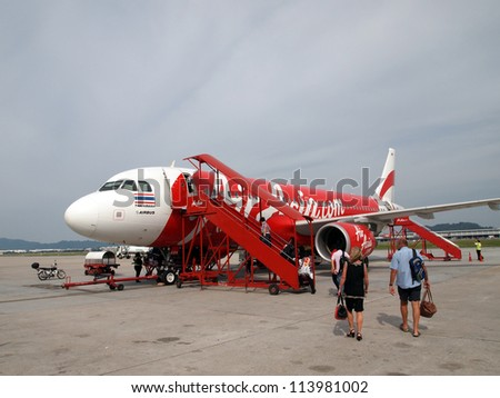 PENANG - SEPTEMBER 1: AirAsia's A320-200 aircraft on September 1, 2012 at Penang Airport, Penang, Malaysia. AirAsia is Asia's largest low-cost carrier and a pioneer of low-cost travel in Asia.