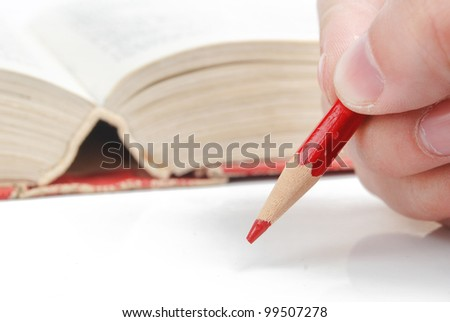 Pencil and dictionary - stock photo