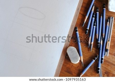 Pencil and empty paper and Eraser on wood table in office top view .Geometry Drafting on white paper and pencil #1097935163