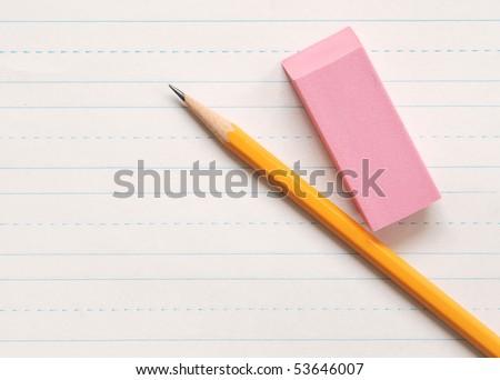 pencil and eraser on penmanship practice paper