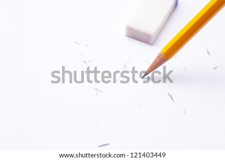 pencil and eraser on white paper background