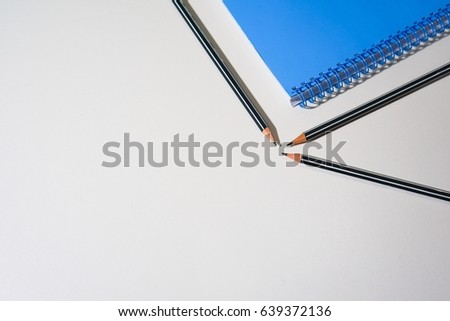 pencil and notebook on white background.represent the business and office supply related equipment. #639372136