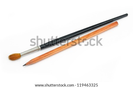 pencil and paint brushes on white background