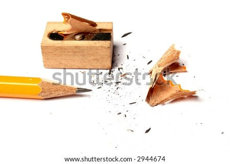 pencil and wooden sharpener and shavings on a white background