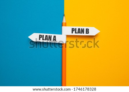Photo of  Pencil - direction indicator - choice of plan a or plan b. Business strategy, failure analysis and not give up.