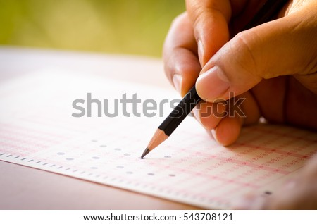 Pencil drawing selected choice on answer sheets