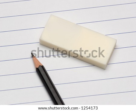 pencil, eraser and lined school paper - stock photo