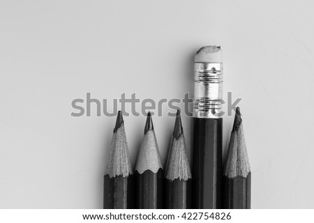 pencil eraser standing out from the row of pencils.
