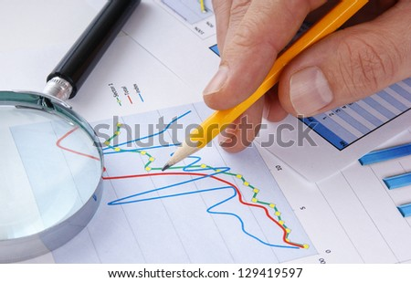 pencil  in hand and working paper chart