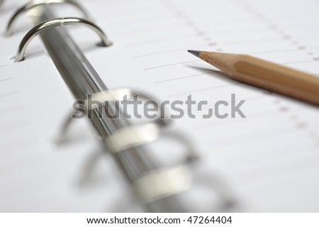 pencil on open business diary - stock photo