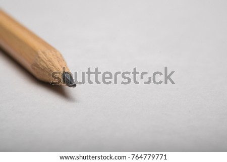 Pencil on white background #764779771