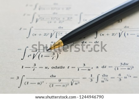 Pencil over a math book and advanced example with integrals