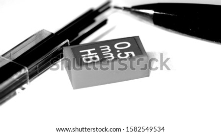 Pencil pencil and pencil sharpener on wallpaper paper