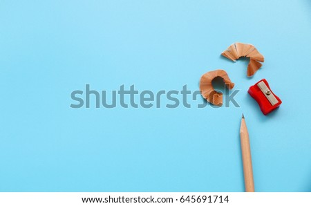 pencil sharpener and pencil blue background,copy space,flat lay #645691714