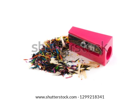 Pencil sharpener and wood shavings isolated on white - Image