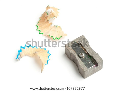 Pencil sharpener with blue and green shavings