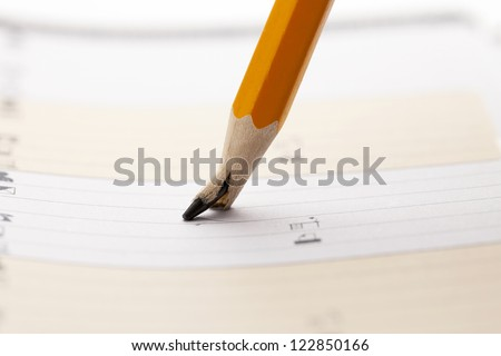 Pencil with a broken tip on the organizer pad background